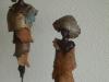 afrikaanse torso's op lange stalen pinnen